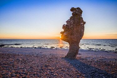 SW03215 Sweden, Faro Island,  Langhammars Area, Langhammar coastal limestone raukar rock, sunset