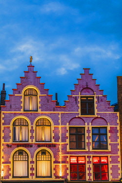 BEL2047AWRF Details of the typical colored houses facades in Markt square in Bruges by night, Belgium