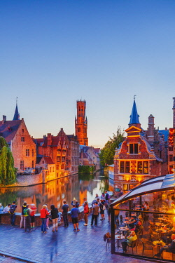 BEL1931AW Elevated view of Bruges old town reflecting in the water canal at sunset by night, Belgium