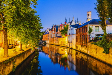 BEL1937AW Elevated view of Bruges old town reflecting in the water canal at sunset by night, Belgium