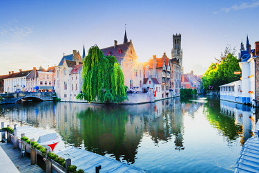 BEL1943AW Bruges old town reflecting in the water canal at sunset, Belgium