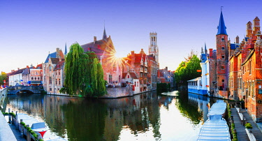 BEL1989AW Panoramic view of Bruges old town reflecting in the water canal at sunset, Belgium