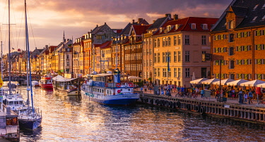 DEN0440AW Panoramic view of Nyhavn water canal at sunset in Copenhagen, Denmark