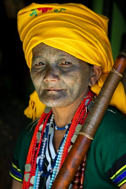 MYA2481AW Portrait of a woman with traditional tattooed face in Mindat, Chin State, Myanmar