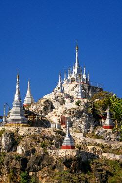 MYA2492AW White pagodas against blue sky near Demoso, Demoso Township, Loikaw District, Kayah State, Myanmar