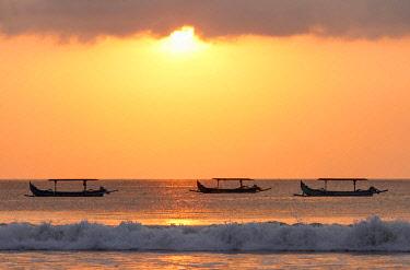 IDA1043AW Indonesia, Bali, Kuta; fishing outriggers on the beach of Kuta; at sunset