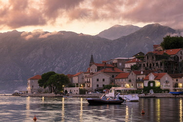 MNT0041AW Montenegro, Bay of Kotor, Perast. The village and surrounding mountains at sunset.
