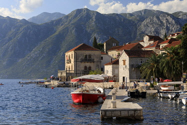 MNT0059AW Montenegro, Bay of Kotor, Perast. The harbour and surrounding mountains.