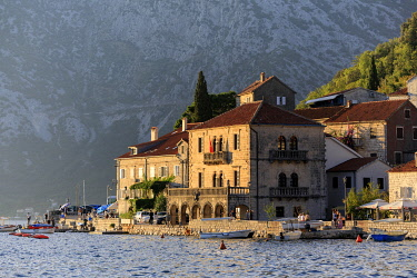 MNT0062AW Montenegro, Bay of Kotor, Perast. Historic buildings and the harbour at sunset.