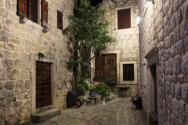 MNT0063AW Montenegro, Bay of Kotor, Perast. Alleyway in the village at night.