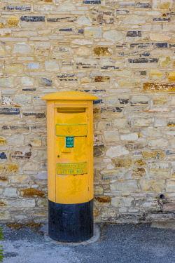 CYP0193AW Yellow letter box in Pano Lefkara, Lefkara Village, Cyprus