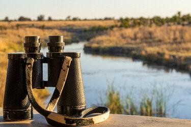 ZIM2732 Hwange National Park, Zimbabwe, Africa.  Game-viewing binoculars at Big Toms hide.