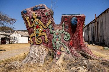 ZIM2808 Harare, Zimbabwe, Africa.  Painted tree trunk at Chapunga Craft Village