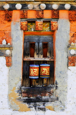 IBLDRN03578352 Prayer wheels in the outer wall of a temple, Jakar, Bumthang district, Bhutan, Asia
