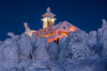 IBXAST04930425 Snow-covered Fichtelberghaus in the evening in winter on the Fichtelberg mountain, Oberwiesenthal, Ore Mountains, Saxony, Germany, Europe