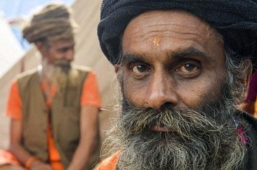 IBLFBD03152369 Portrait of a Udaisin Sadhu, holy man, at the Sangam, the confluence of the rivers Ganges, Yamuna and Saraswati, during Kumbha Mela festival, Allahabad, Uttar Pradesh, India, Asia