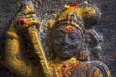 IBLOMK03643547 Guardian figure with a sword, decorated with red and yellow kumkum powder, Meenakshi Amman Temple or Sri Meenakshi Sundareswarar Temple, Madurai, Tamil Nadu, India, Asia