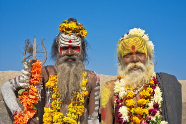 IBLWGB03156283 Two sadhus, holy men with a typical face painting, one holding a Trishula trident, Orchha, Madhya Pradesh, India, Asia