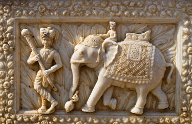 IBLWGB03165712 Relief in a marble fa�ade, mahout or elephant driver and elephant, rat temple of the goddess Karni Mata, Karni Mata Temple, Deshnok, Rajasthan, India, Asia