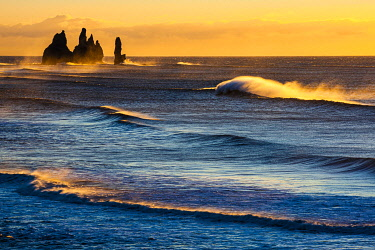IBXKHI05032003 Reynisdrangar, stormy sea at sunrise, near Reynisfjara, Sudurland, South Iceland, Iceland, Europe