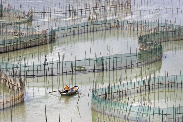 HMS3362159 China, Fujiang Province, Xiapu County, Cages with nets for raising fish in open sea, Fish Farming, boat