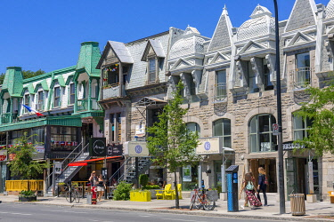 HMS3373381 Canada, Province of Quebec, Montreal, Plateau-Mont-Royal, Saint-Denis Street with its shops and houses with typical Montreal architecture