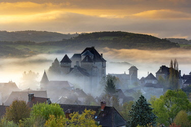 FRA11780AW Curemonte labelled l'un des plus beaux villages de France (most beautiful villages in France) in the morning mist, Correze, Nouvelle-Aquitaine, France
