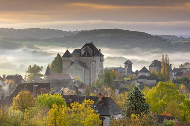 FRA11781AW Curemonte labelled l'un des plus beaux villages de France (most beautiful villages in France) in the morning mist, Correze, Nouvelle-Aquitaine, France