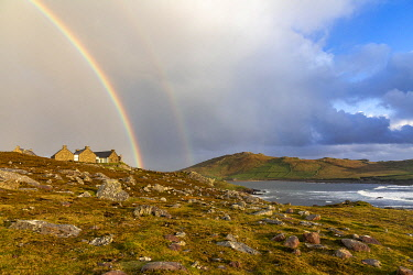 IRL1014AWRF A rainbow sits above an old house in western Achill Island, , Achill Island, County Mayo, Connacht province, Republic of Ireland