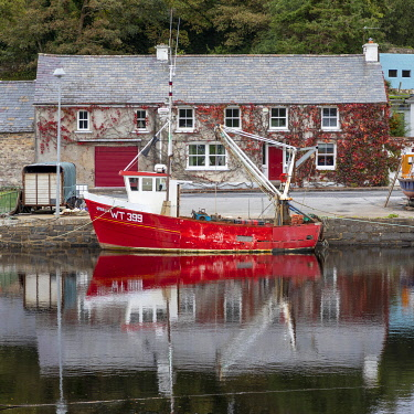IRL1021AW A red fishing boat moored on Newport river, Newport, County Mayo, Connacht province, Republic of Ireland