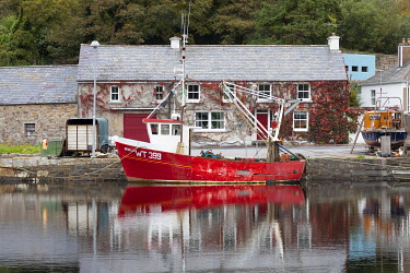 IRL1022AW A red fishing boat moored on Newport river, Newport, County Mayo, Connacht province, Republic of Ireland