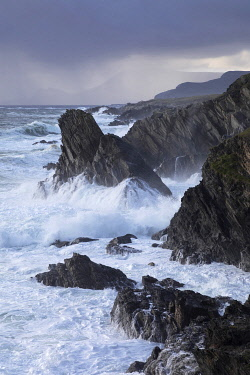 IRL1026AW Waves hit the cliffs in Western Achill Island, Achill Island, County Mayo, Connacht province, Republic of Ireland