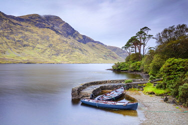 IRL1032AW Rowing boats moored up on Doo Lough Lake,   County Mayo, Connacht province, Republic of Ireland, Europe