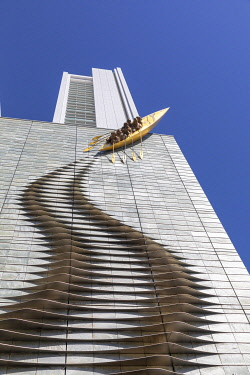 JAP2098AW A sculpture of a canoe climbing a highrise building in Central Osaka, Osaka, Kansai, Japan