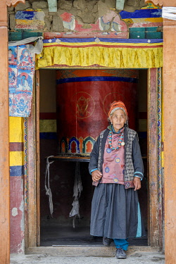 HMS3435180 India, state of Jammu and Kashmir, Himalayas, Ladakh, Indus Valley, Leh (3500m), annual Ladakh Festival, Buddhist temple of Gompa Soma (Chokhang), an elderly woman comes out of a temple room after tur...