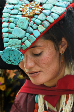 India, Jammu and Kashmir, Ladakh, Nubra valley, Samsthaling monastery, Young Ladakhi woman wearing the traditional perak (Headdress)