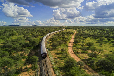 HMS3126659 Namibia, Otjozondjupa region, the Shongololo express train crossing the Namibian bush towards Kalkfeld (aerial view)