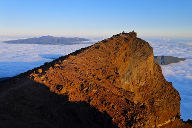 HMS3298421 France, Reunion island, Cilaos, Salazie, sunset on the south summit of Piton des Neiges, listed as World Heritage by UNESCO