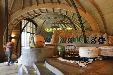HMS3522645 Rwanda, Volcanoes National Park, interior of the Bisate Lodge, a lodge of the Wilderness Safaris hotel group, whose design is inspired by the former royal palace of Nyanza