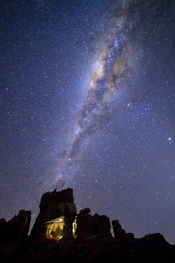 HMS3657550 South Africa, Western Cape, Milky Way and starry night on a cave in the Cederberg Massif