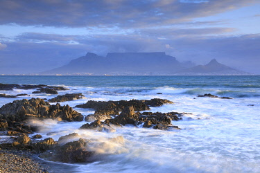 HMS3657566 South Africa, Western Cape, Cape Town Sunset and Table Mountain NP from Blougstrand