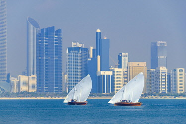 HMS3263425 United Arab Emirates, Abu Dhabi, Al Marina district, dhows, traditional sailboats, the Corniche and the skyscrapers of Al Markaziyah district in the background