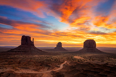 USA14953AW The Mittens against colourful cloudy sky at sunrise, Monument Valley, Arizona, USA