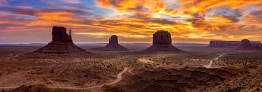 USA14954AW The Mittens against colourful cloudy sky at sunrise, Monument Valley, Arizona, USA