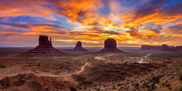 USA14955AW The Mittens against colourful cloudy sky at sunrise, Monument Valley, Arizona, USA