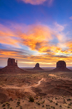 USA14956AW The Mittens against colourful cloudy sky at sunrise, Monument Valley, Arizona, USA