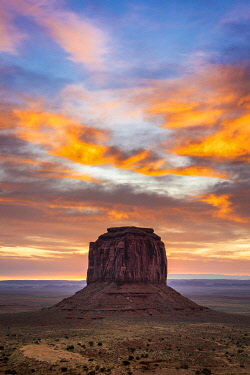 USA14957AW Merrick Butte against colourful cloudy sky at sunrise, Monument Valley, Arizona, USA