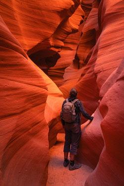 USA14969AW Young male tourist admiring slot canyon walls, Antelope Canyon X, Page, Arizona, USA, MR