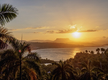 CUB1586AWRF View over Bahia de Miel towards city and El Yunque Mountain, sunset, Baracoa, Guantanamo Province, Cuba