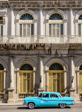 CUB1677AWRF Vintage car passing in front of Casino Espanol, Libertad Square, Matanzas, Matanzas Province, Cuba